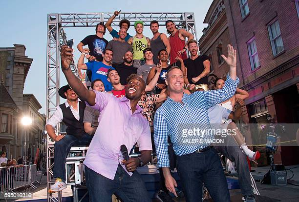 Hosts Akbar Gbajabiamila and Matt Iseman Pose with the competitors at the 'American Ninja Warrior' screening and course demonstration In celebration...