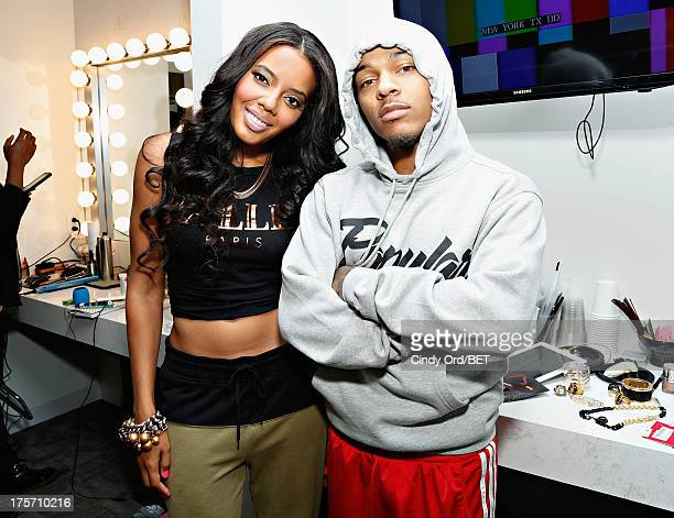 Hosts Angela Simmons and Bow Wow pose backstage at BET's '106 and Park' at BET Studios on August 5 2013 in New York City