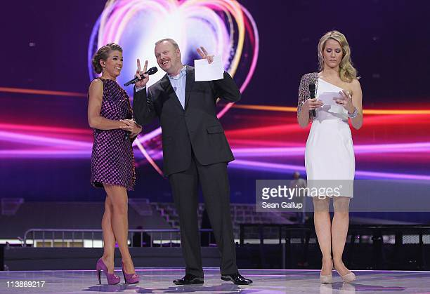Hosts Anke Engelke Stefan Raab and Judith Rakers attend a dress rehearsal the day before the first semifinals of the Eurovision Song Contest 2011 on...