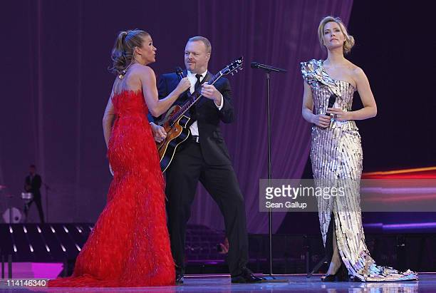 Hosts Anke Engelke Stefan Raab and Judith Rakers lead the dress rehearsal ahead of the finals of the 2011 Eurovision Song Contest on May 13 2011 in...
