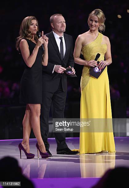 Hosts Anke Engelke Stefan Raab and Judith Rakers lead the second semifinals of the Eurovision Song Contest 2011 on May 12 2011 in Duesseldorf Germany