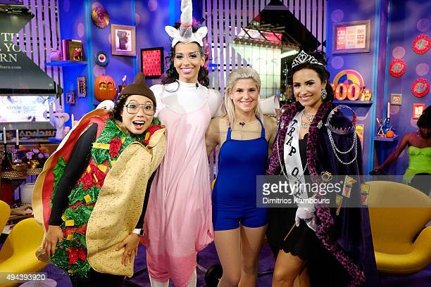 Hosts Awkwafina Nessa and Carly Aquilino speak with Singer Demi Lovato at MTV's 'Girl Code Live' at MTV Studios on October 26 2015 in New York City