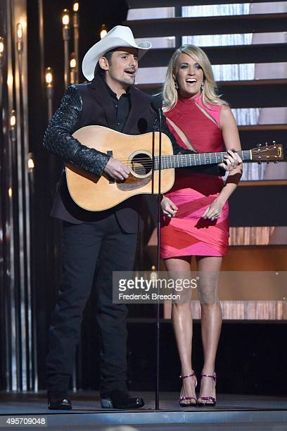 Hosts Brad Paisley and Carrie Underwood perform onstage at the 49th annual CMA Awards at the Bridgestone Arena on November 4 2015 in Nashville...