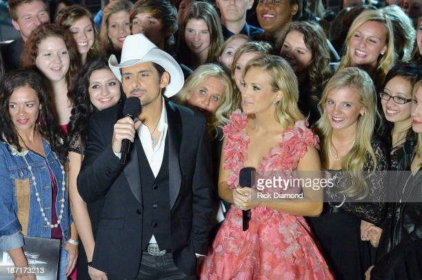 Hosts Brad Paisley and Carrie Underwood speak during the 47th annual CMA Awards at the Bridgestone Arena on November 6 2013 in Nashville Tennessee