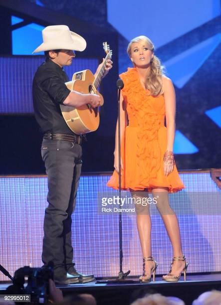 Hosts Brad Paisley and Carrie Underwood speak onstage during the 43rd Annual CMA Awards at the Sommet Center on November 11 2009 in Nashville...