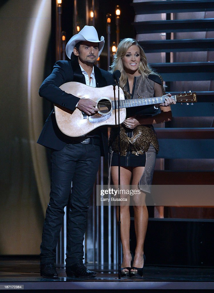 Hosts Brad Paisley (L) and Carrie Underwood speak onstage during the 47th annual CMA awards at the Bridgestone Arena on November 6, 2013 in Nashville, United States.