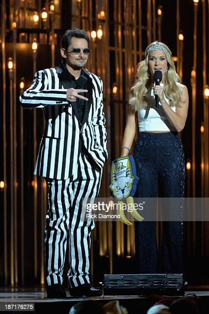 Hosts Brad Paisley and Carrie Underwood speak onstage during the 47th annual CMA awards at the Bridgestone Arena on November 6 2013 in Nashville...