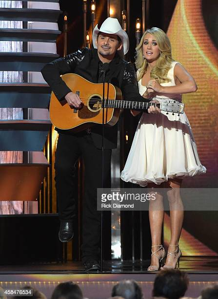 Hosts Brad Paisley and Carrie Underwood speak onstage during the 48th annual CMA awards at the Bridgestone Arena on November 5 2014 in Nashville...