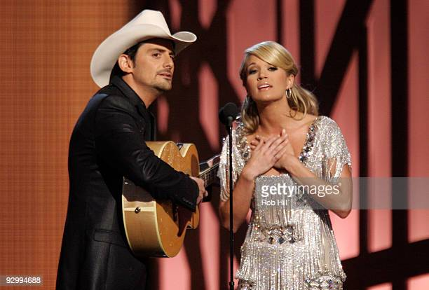 Hosts Brad Paisley and Carrie Underwoood perform onstage at the 43rd Annual CMA Awards at the Sommet Center on November 11 2009 in Nashville Tennessee