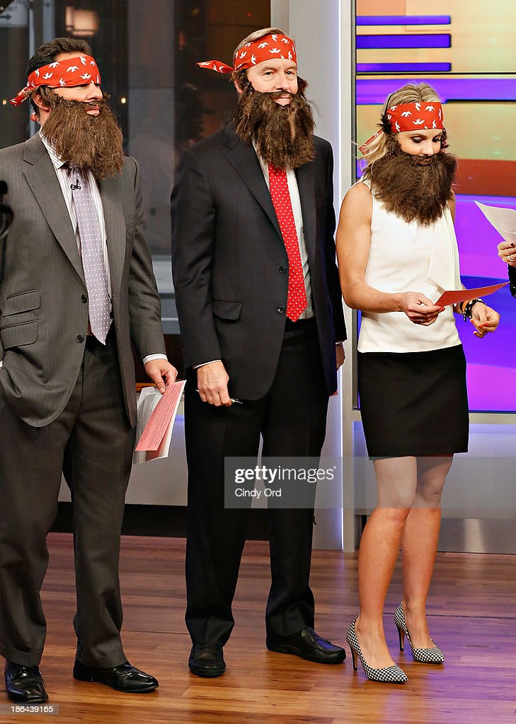 Hosts Brian Kilmeade, Steve Doocy and Elisabeth Hasselbeck wear 'Duck Dynasty' costumes as 'FOX & Friends' celebrates Halloween at FOX Studios on October 31, 2013 in New York City.