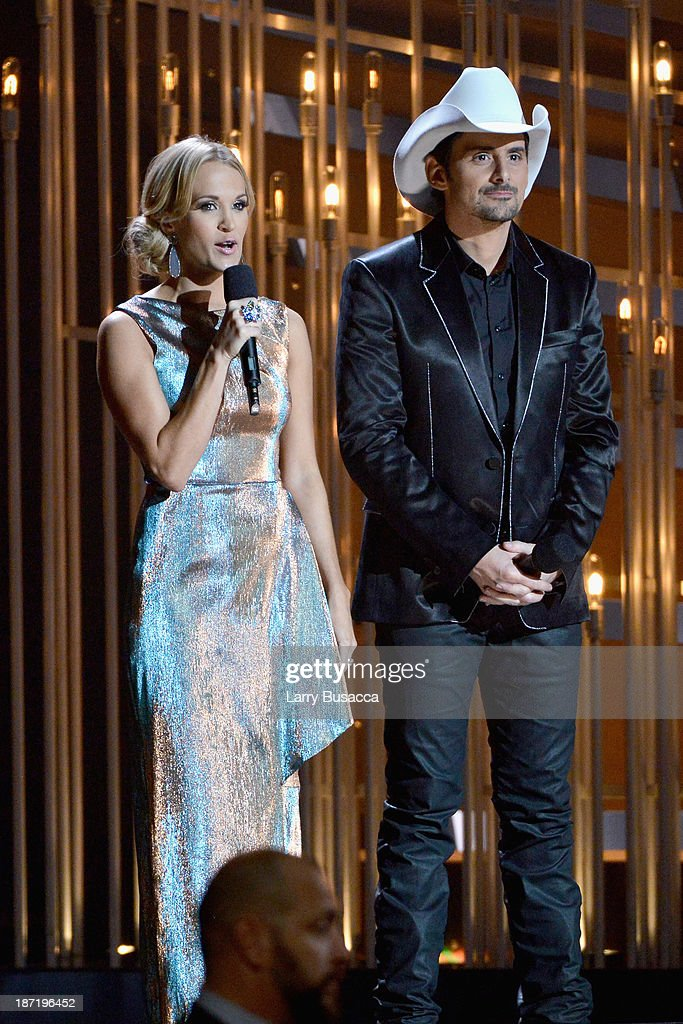 Hosts Carrie Underwood (L) and Brad Paisley speak onstage during the 47th annual CMA awards at the Bridgestone Arena on November 6, 2013 in Nashville, United States.
