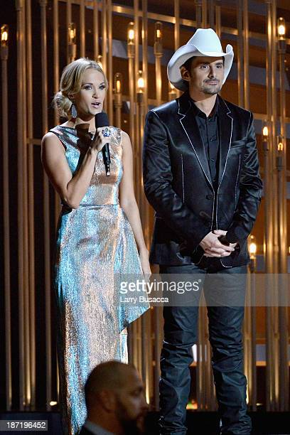 Hosts Carrie Underwood and Brad Paisley speak onstage during the 47th annual CMA awards at the Bridgestone Arena on November 6 2013 in Nashville...