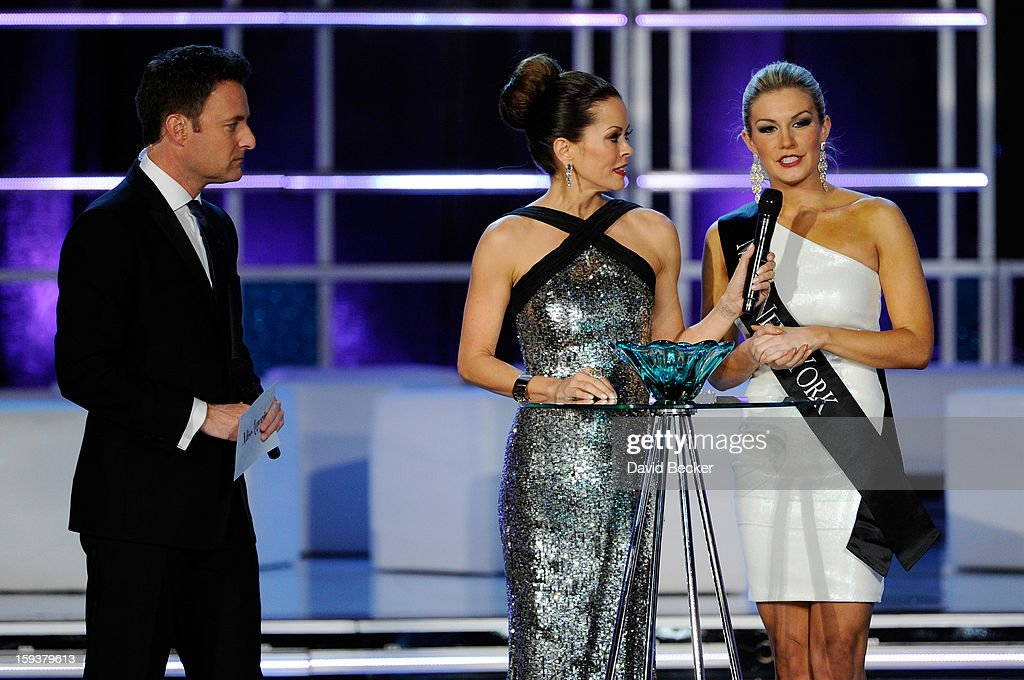 Hosts Chris Harrison (L) and Brooke Burke Charvet (C) stand by as Mallory Hytes Hagan, Miss New York, answers a question during the interview portion at the 2013 Miss America Pageant at PH Live at Planet Hollywood Resort & Casino on January 12, 2013 in Las Vegas, Nevada. Hagan went on to be crowned the new Miss America.