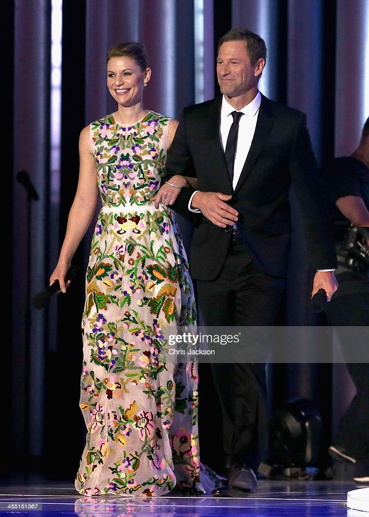 Hosts Claire Danes and Aaron Eckhart arrive on stage during the 20th annual Nobel Peace Prize Concert at the Oslo Spektrum on December 11, 2013 in Oslo, Norway.