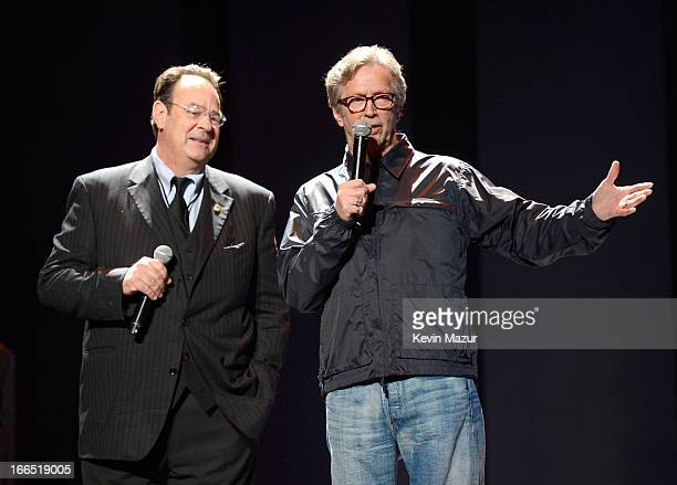 Hosts Dan Aykroyd and Eric Clapton speak on stage during the 2013 Crossroads Guitar Festival at Madison Square Garden on April 13 2013 in New York...