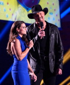Hosts Danica Patrick and Trace Adkins speak onstage during the American Country Awards 2013 at the Mandalay Bay Events Center on December 10 2013 in...