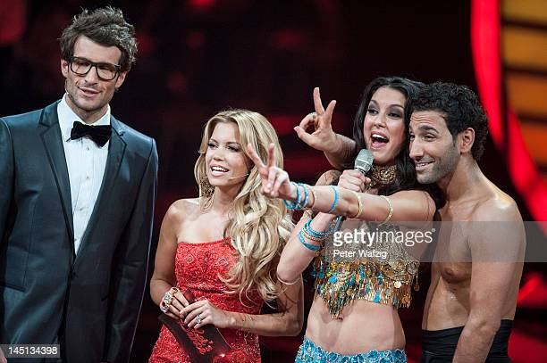 Hosts Daniel Hartwich and Sylvie van der Vaart together with finalists Massimo Sinato and Rebecca Mir during 'Let's Dance' Finals at Coloneum on May...