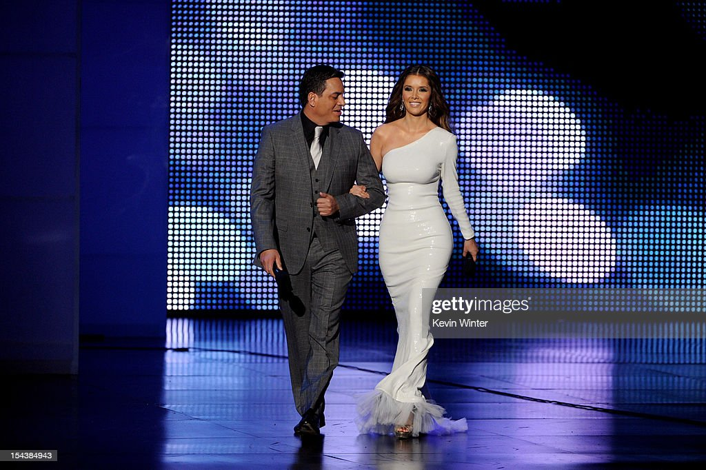 Hosts Daniel Sarcos (L) and <a gi-track='captionPersonalityLinkClicked' href=/galleries/search?phrase=Marlene+Favela&family=editorial&specificpeople=750960 ng-click='$event.stopPropagation()'>Marlene Favela</a> appear onstage at the Billboard Mexican Music Awards presented by State Farm on October 18, 2012 in Los Angeles, California.