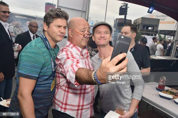 Hosts David Burtka and Andrew Zimmern and actor Neil Patrick Harris attend the Food Network Cooking Channel New York City Wine Food Festival...