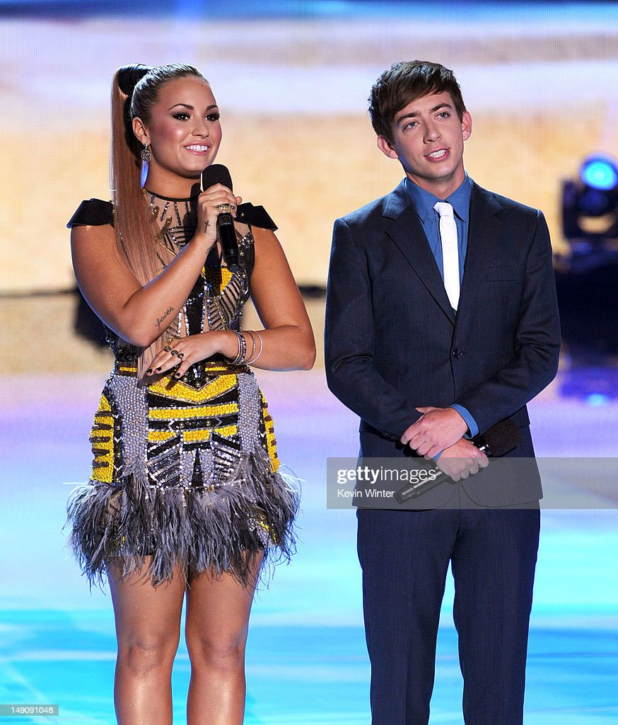 Hosts Demi Lovato (L) and Kevin McHale speak onstage during the 2012 Teen Choice Awards at Gibson Amphitheatre on July 22, 2012 in Universal City, California.