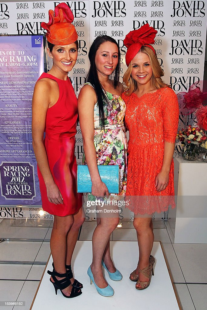 Hosts for the event Kate Waterhouse (L) and Emma Freedman (R) pose with jockey Katelyn Mallyon at the David Jones High Tea & Spring Millinery Event at David Jones Bourke Street Mall on October 12, 2012 in Melbourne, Australia.