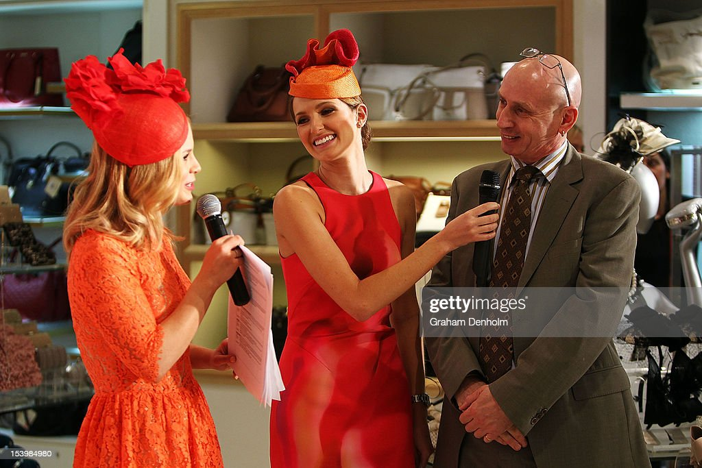 Hosts for the event Kate Waterhouse (C) and Emma Freedman (L) talk to milliner Neil Grigg during the David Jones High Tea & Spring Millinery Event at David Jones Bourke Street Mall on October 12, 2012 in Melbourne, Australia.
