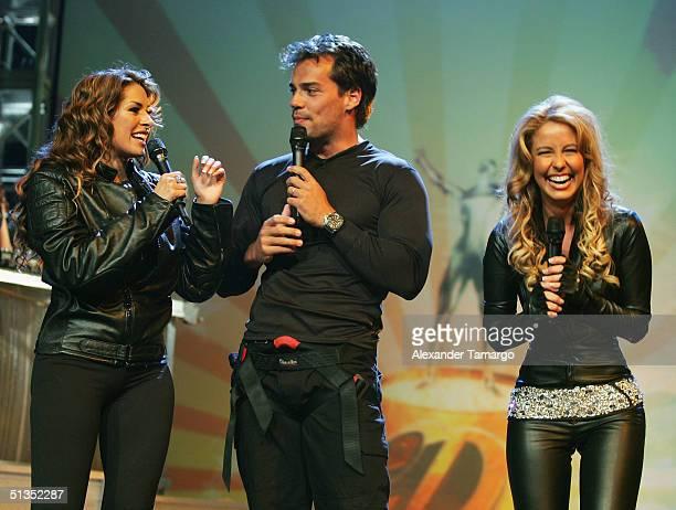 Hosts Galilea Montijo Cristian de la Fuente and Myrka Dellanos onstage at the 1st Annual Premios Juventud Awards at the James L Knight Center...