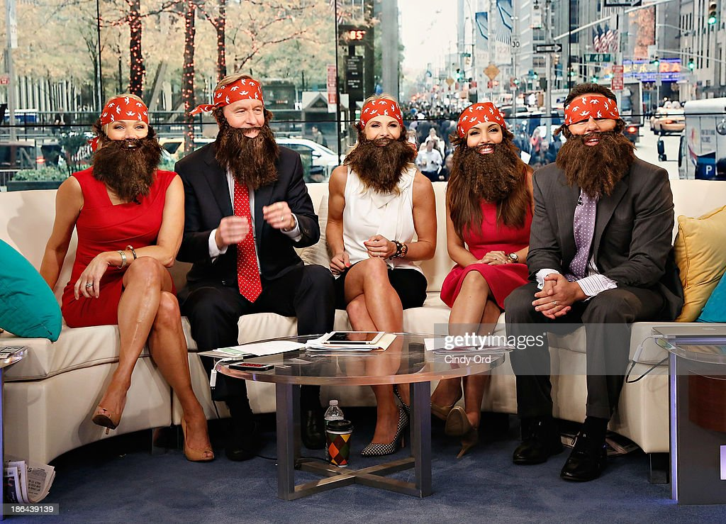 Hosts Heather Childers, Steve Doocy, Elisabeth Hasselbeck, Brian Kilmeade and Maria Molina wear 'Duck Dynasty' costumes as 'FOX & Friends' celebrates Halloween at FOX Studios on October 31, 2013 in New York City.