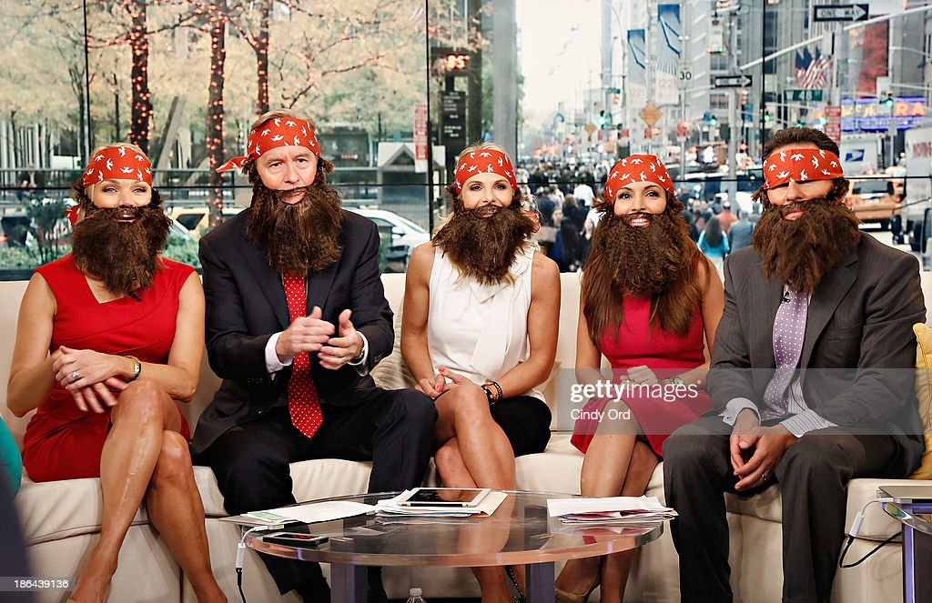 Hosts Heather Childers, Steve Doocy, Elisabeth Hasselbeck, Maria Molina and Brian Kilmeade wear 'Duck Dynasty' costumes as 'FOX & Friends' celebrates Halloween at FOX Studios on October 31, 2013 in New York City.