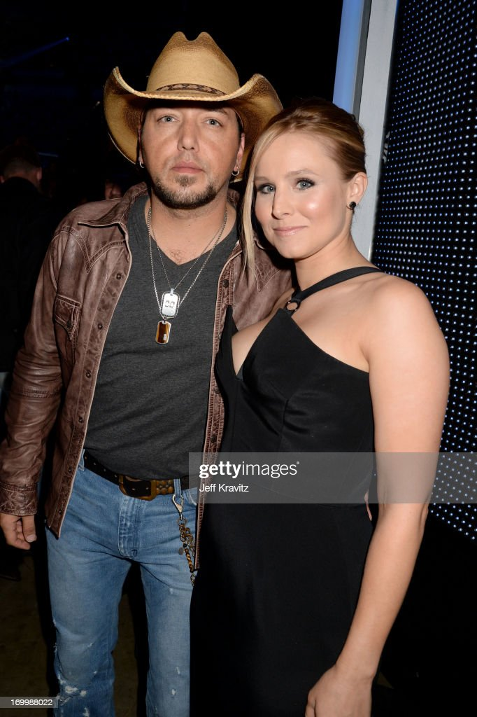 Hosts <a gi-track='captionPersonalityLinkClicked' href=/galleries/search?phrase=Jason+Aldean&family=editorial&specificpeople=619221 ng-click='$event.stopPropagation()'>Jason Aldean</a> and <a gi-track='captionPersonalityLinkClicked' href=/galleries/search?phrase=Kristen+Bell&family=editorial&specificpeople=194764 ng-click='$event.stopPropagation()'>Kristen Bell</a> pose backstage at the 2013 CMT Music Awards at the Bridgestone Arena on June 5, 2013 in Nashville, Tennessee.