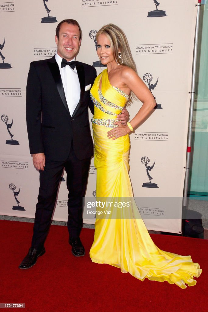 TV hosts Joseph McDonald (L) and Tamara Henry arrive at the Academy of Television Arts & Sciences 65th Los Angeles Area Emmy Awards at Leonard H. Goldenson Theatre on August 3, 2013 in North Hollywood, California.