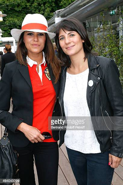 TV hosts Karine Ferry and Estelle Denis attend the Roland Garros French Tennis Open 2014 Day 3 on May 27 2014 in Paris France