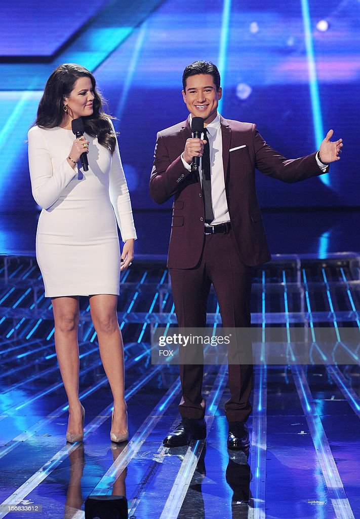 Hosts Khloe Kardashian Odom and Mario Lopez onstage at FOX's 'The X Factor' Season 2 Top 10 Live Performance Show on November 21, 2012 in Hollywood, California.
