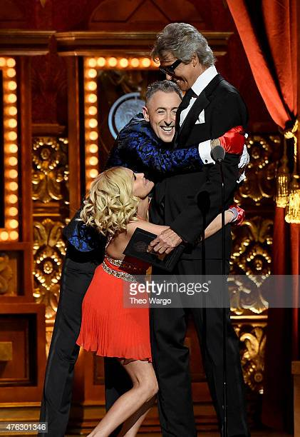 Hosts Kristen Chenoweth and Alan Cumming hug Tommy Tune as he accepts a Special Tony Award for Lifetime Achievement in the Theatre performs onstage...