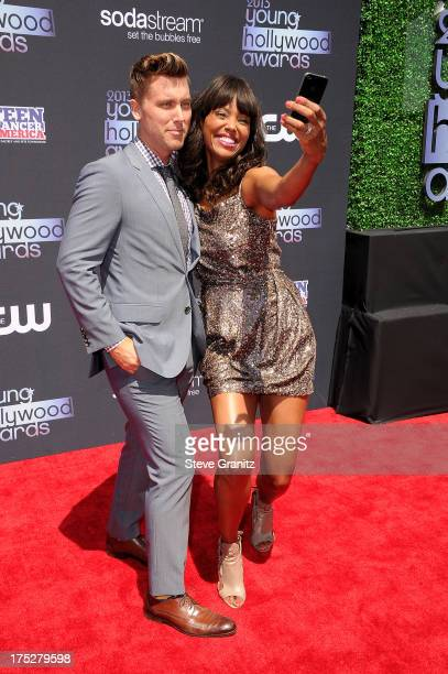Hosts Lance Bass and Aisha Tyler attend CW Network's 2013 Young Hollywood Awards presented by Crest 3D White and SodaStream held at The Broad Stage...