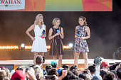 ABC hosts Lara Spencer Amy Robach and Ginger Zee on stage while Sia Performs on 'Good Morning America' on July 22 2016 in New York City