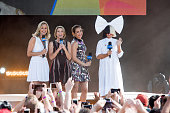 ABC hosts Lara Spencer Amy Robach and Ginger Zee with Sia on stage while Sia Performs on 'Good Morning America' on July 22 2016 in New York City