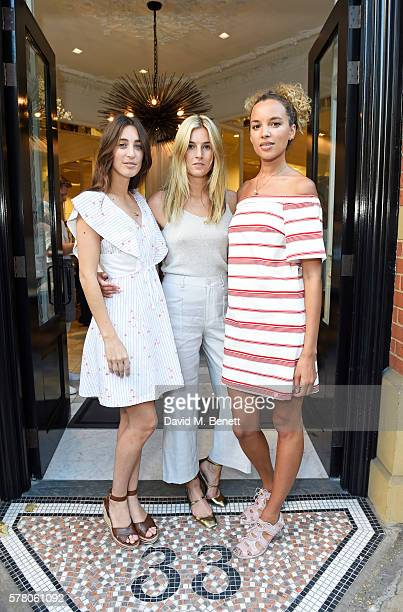 Hosts Laura Jackson Camille Charriere and Phoebe CollingsJames attend the Club Monaco Summer Cocktail Party on July 20 2016 in London England