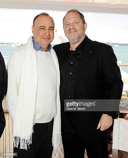 Hosts Len Blavatnik and Harvey Weinstein attend a lunch hosted by Len Blavatnik Harvey Weinstein and Warner Music during the 65th Cannes Film...