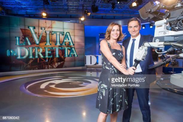 TV hosts Liorni Marco and Cristina Parodi next to a TV camera in the studios of the TV program La vita in diretta Rome Italy 4th November 2015