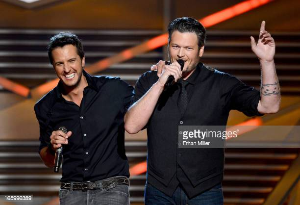 Hosts Luke Bryan and Blake Shelton speak onstage during the 48th Annual Academy of Country Music Awards at the MGM Grand Garden Arena on April 7 2013...