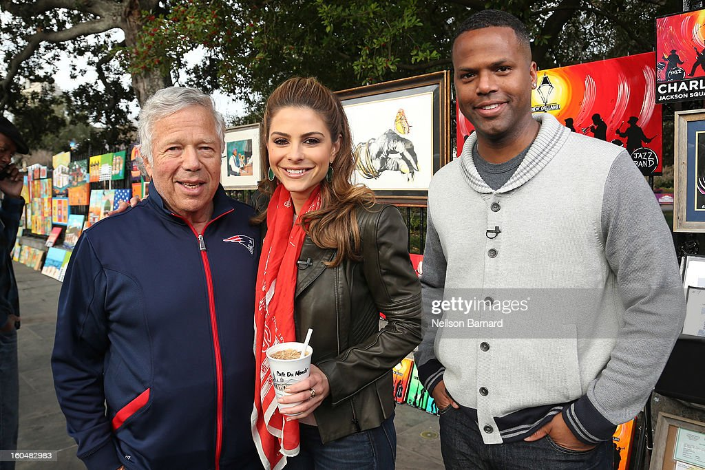 Hosts <a gi-track='captionPersonalityLinkClicked' href=/galleries/search?phrase=Maria+Menounos&family=editorial&specificpeople=203337 ng-click='$event.stopPropagation()'>Maria Menounos</a> and AJ Calloway along with New England Patriots owner <a gi-track='captionPersonalityLinkClicked' href=/galleries/search?phrase=Robert+Kraft&family=editorial&specificpeople=221220 ng-click='$event.stopPropagation()'>Robert Kraft</a> tape a segment for 'Extra' in Jackson Square on February 1, 2013 in New Orleans, Louisiana.