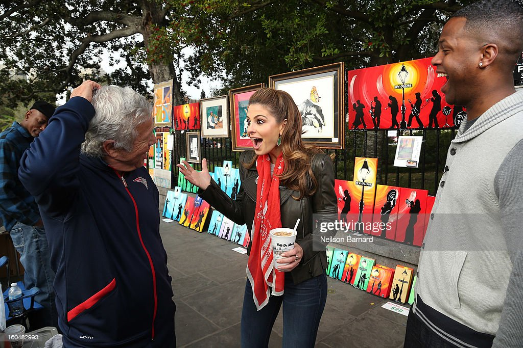 Hosts Maria Menounos and AJ Calloway along with New England Patriots owner Robert Kraft tape a segment for 'Extra' in Jackson Square on February 1, 2013 in New Orleans, Louisiana.