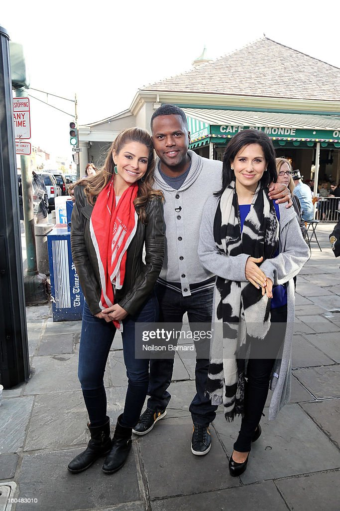 Hosts <a gi-track='captionPersonalityLinkClicked' href=/galleries/search?phrase=Maria+Menounos&family=editorial&specificpeople=203337 ng-click='$event.stopPropagation()'>Maria Menounos</a> and AJ Calloway and guest <a gi-track='captionPersonalityLinkClicked' href=/galleries/search?phrase=Hilaria+Baldwin&family=editorial&specificpeople=7856471 ng-click='$event.stopPropagation()'>Hilaria Baldwin</a> tape a segment for 'Extra' in Jackson Square on February 1, 2013 in New Orleans, Louisiana.
