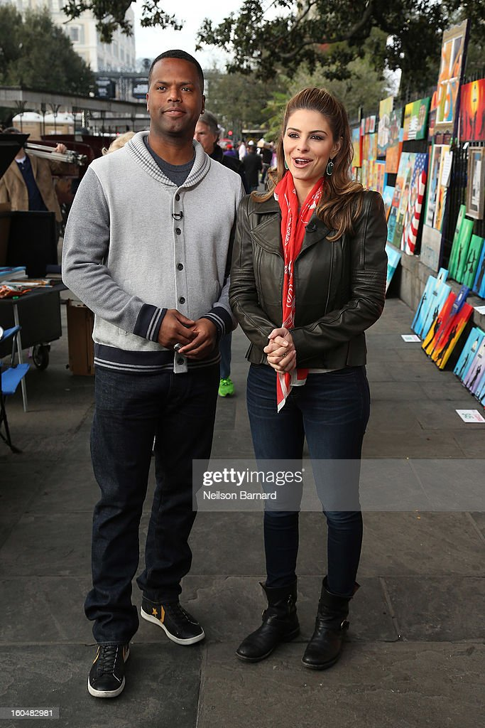 Hosts Maria Menounos and AJ Calloway tape a segment for 'Extra' in Jackson Square on February 1, 2013 in New Orleans, Louisiana.