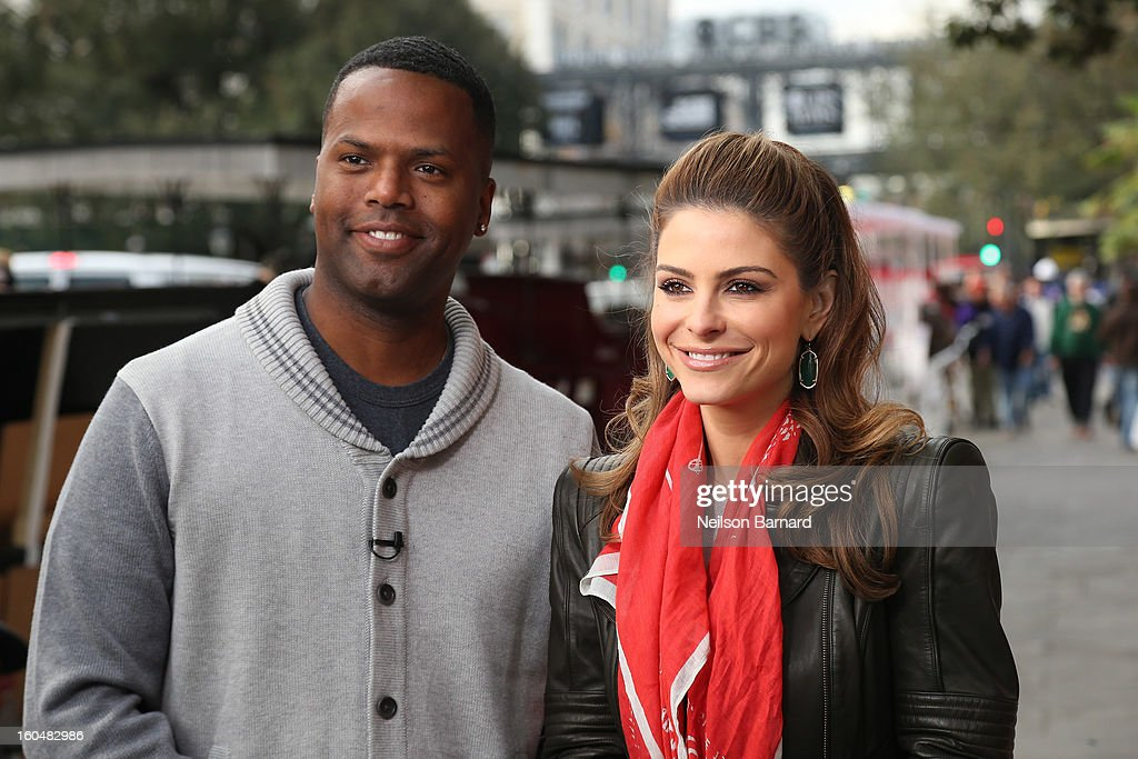 Hosts <a gi-track='captionPersonalityLinkClicked' href=/galleries/search?phrase=Maria+Menounos&family=editorial&specificpeople=203337 ng-click='$event.stopPropagation()'>Maria Menounos</a> and AJ Calloway tape a segment for 'Extra' in Jackson Square on February 1, 2013 in New Orleans, Louisiana.