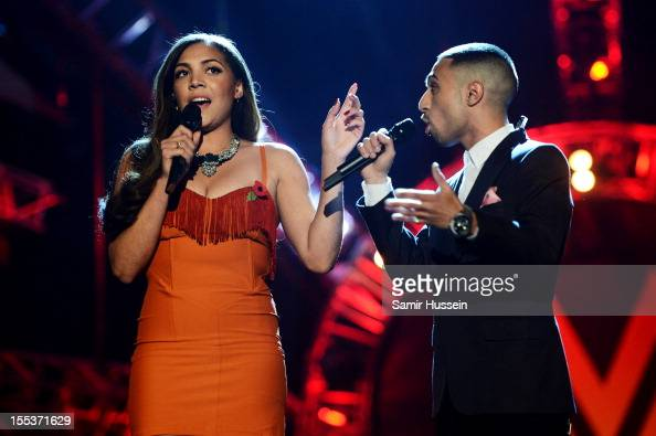 Hosts Miquita Oliver and Adam Deacon speak onstage at the 2012 MOBO awards at Echo Arena on November 3 2012 in Liverpool England