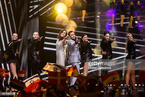 Hosts Petra Mede and Mans Zelmerlow perform during the semifinals of the 2016 Eurovision Song Contest at Ericsson Globe Arena on May 12 2016 in...