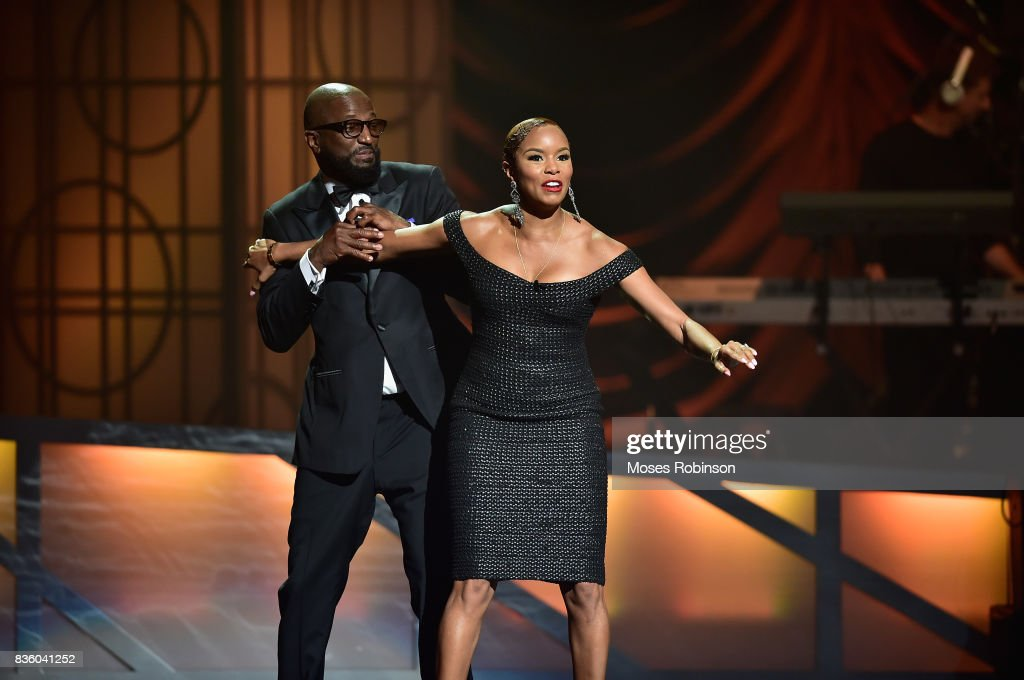 Hosts Rickey Smiley (L) and Letoya Luckett (R) speak onstage at the 2017 Black Music Honors at Tennessee Performing Arts Center on August 18, 2017 in Nashville, Tennessee.