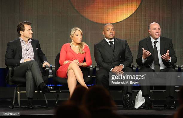 Hosts Robert Herjavec Lori Greiner Daymond John and Kevin O'Leary of 'Shark Tank' speak onstage during the ABC portion of the 2013 Winter TCA Tour at...